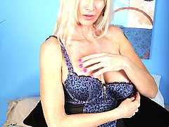 Older cougar Cameo exposes her big mature tits.