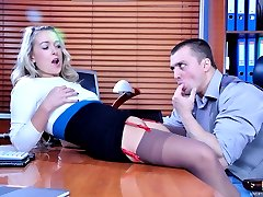 Sexy blonde in dark stockings with a red-n-black garter having office sex