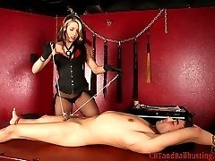 Mistress Dahlia has her slave in bondage on her table. Dahlia ties his balls separately to hang...