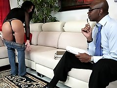 A buxom white milf fucks the hell out of a black stud here
