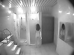 Girl takes a shower unsuspecting of spy cam