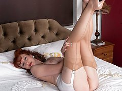 Mature stunner Red strips down to open bottom girdle, vintage nylons and stunning hand made pink...