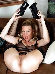 Lots of sheer black nylon, with vintage bra, garter belt and classic black Harmony Points to...