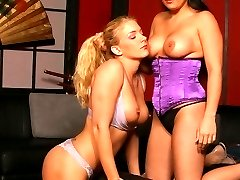 Corseted lesbian Emma licks a sweet lesbo pussy in this hot lesbian loving scene