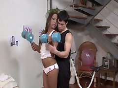 Tanned muscle tranny Angeli gets a real workout from Ozzy in this video. After putting her own...