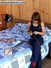 Young lovely held down on the bed to receive blistering caning on her pert little bottom