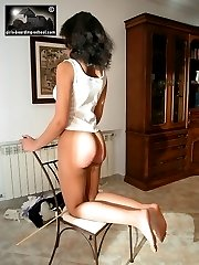 Naked teen touches toes for the cane