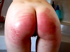 Teen babe naked and soaked in the bathroom - painful strapping on her wet young ass