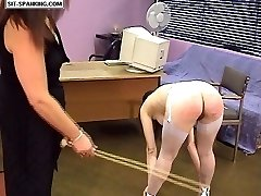 Stunning naked girl in stockings touches her toes and spreads her legs during severe caning