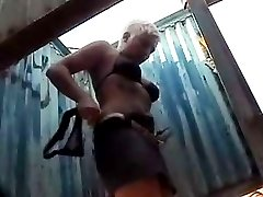 Voyeur put a hidden cam under the beach cabins to picture hot bare chicks