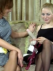 Dolled-up pussy guy gags on a big strap-on cock craving for anal screwing