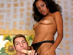 Beautiful black babe balls man in the rear with large strap-on!