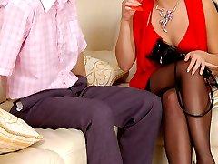 Wanton gal taking wild pleasure from strap-on fucking her boyfriend on sofa