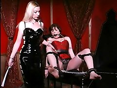 Mistress Erzsebet ball gags and binds her slave Alsara Sin while inflicting pain in this BDSM...