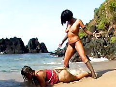 This is not Lesbos Island, but a beautiful domme strapon-fucks her sexy slave right on the beach