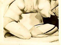 Two bare titted dolls posing in splendid retro pics
