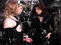 Male maid in latex outfit gets his nipples and cock punished
