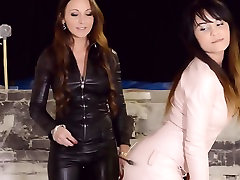 2 lesbians dominating in leather and boots smoking fetish