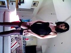 Having fun in my black leather mini dress part two