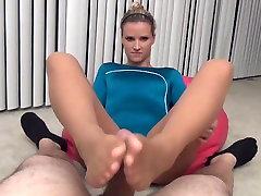 Gymnast gives a Pantyhose Footjob to Coach