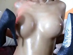 Oiled blonde fucks herself with her kate england domination mistress heels