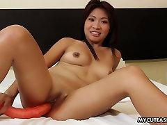 Cute Asian floozy dildo fucks her wet pussy