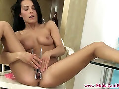 Masturbating babe toys and spreads her pussy