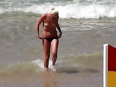 topless blonde in thong bikini at beach voyeur candid