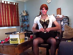 stripping out of a secretary outfit to reveal a black basque