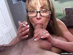 asia cabby smokes cigarette while sucking cock