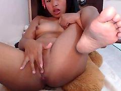 Nice asian girl masturbating with vibrating dildo