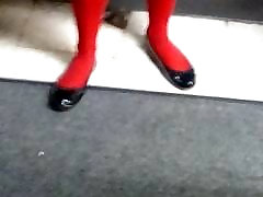 Red pantyhose with black flats