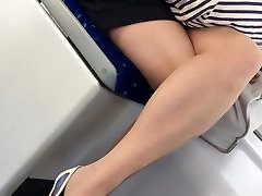 Candid Beauty in Pantyhose Nylons on Tram Legs