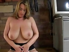 Mature playing with big boobs