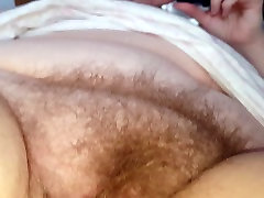 rubbing her soft emanuelle lyon hairy pussy mound