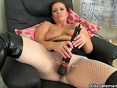 British milf Sam works her lickng my pussy with a huge vibrator
