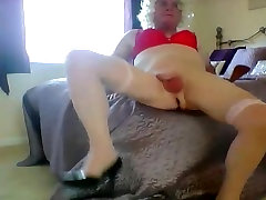 sissy ken opens curtains then spanks his cock,balls and arse