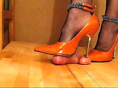 Orange metal heels giving painful cock crushing