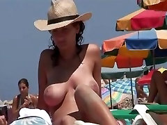 Topless girl with eva knotty fucked in gym toilet sex www and a hat on the beach