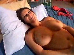 Brunette masturbates in bed for you!