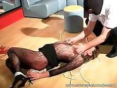 Mature bitch gets tied and fucked with dildo