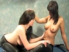 two girls smoking on a pool table