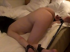 Young girl fucked in a steel sprederbar by an older man,
