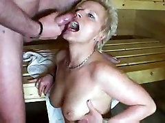 Mature blond lady in towel gets her fill in the Sauna