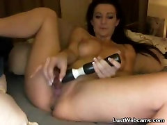 Busty Milf dildoing her pussy on cam