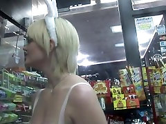 Busty girl next door touching her cunt in a store