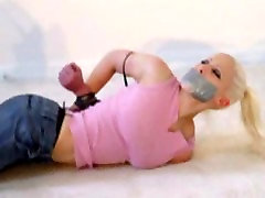 blonde barefoot in girl jerks her guy tied and tapegagged on the carpet