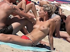 Lovely blonde Topless on the Beach