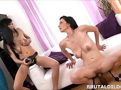 Brunette lesbians sharing a big black brutal gay massage tum dildo in HD
