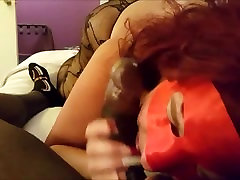 Masked Cougar devouring a big black sausage